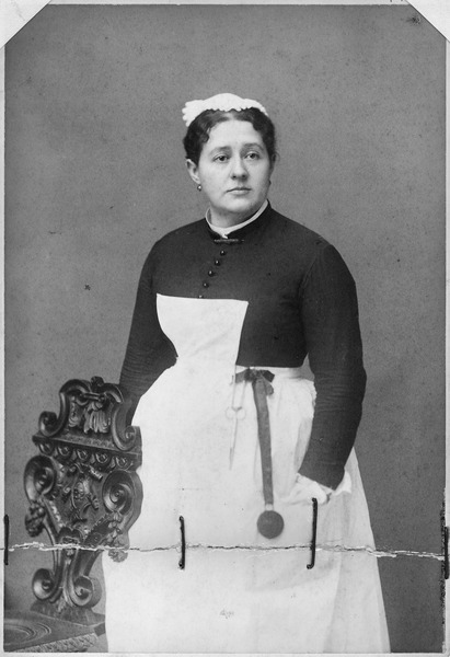 Woman in Maid's Uniform circa 1884