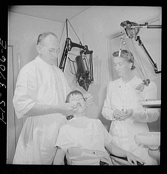 Dr._James_McCarl_and_dental_assistant_with_young_patient
