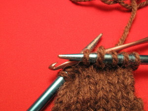 800px-Knitting_dropped_stitch_6