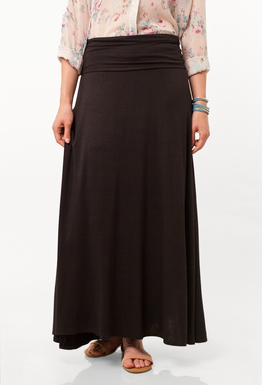 Innovative Hispanic Woman Wearing Black Pants And Blue Top Stock Photography
